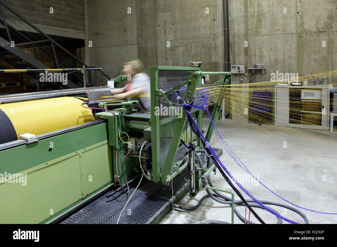 Inside a textile factory. Spin machine. - Stock Image
