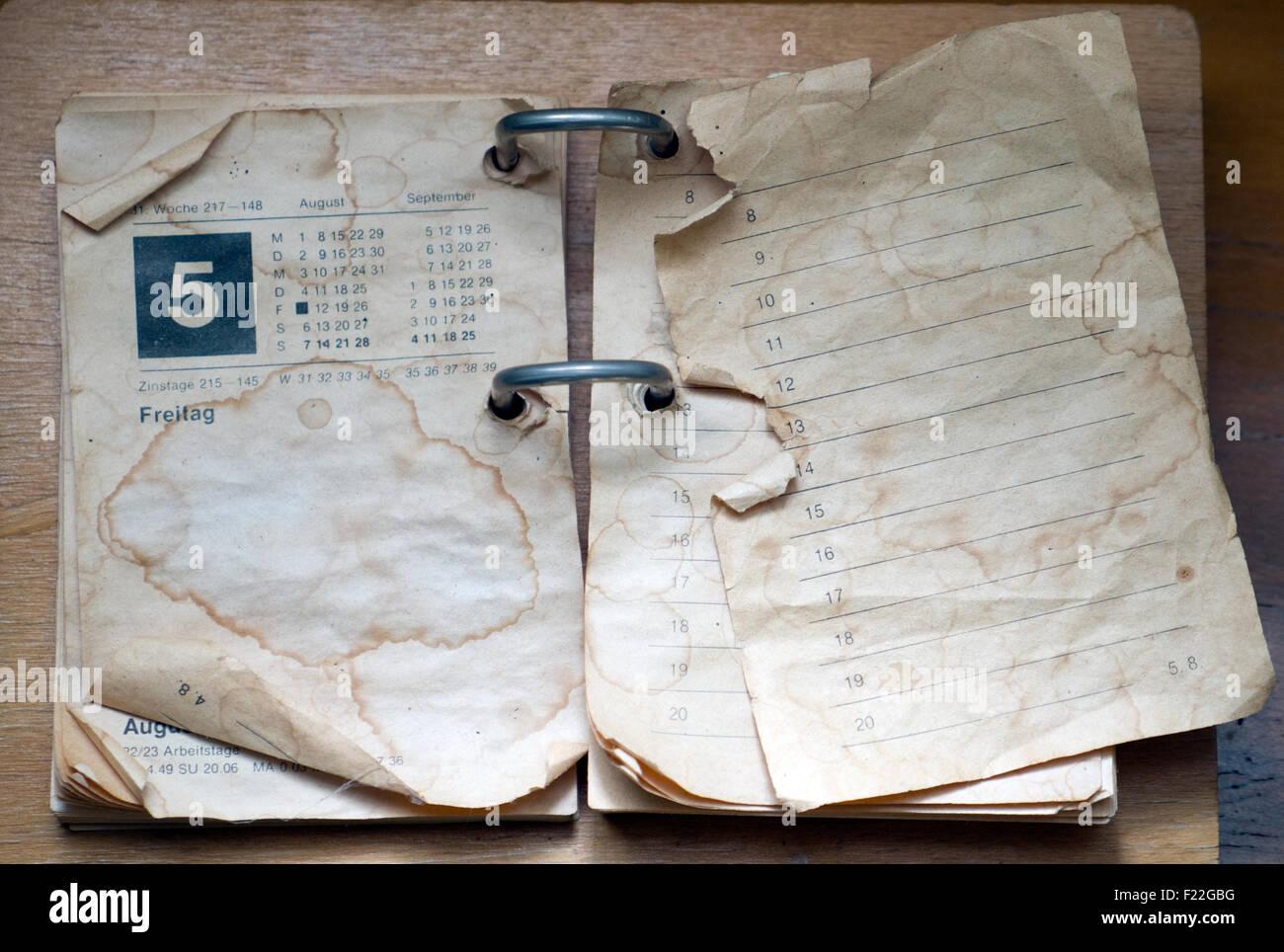 Alter fleckiger Kalender - Stock Image