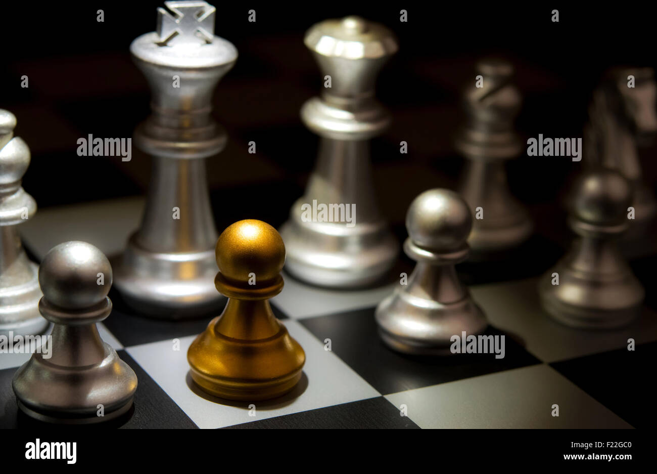 Stand out of a crowd individuality concept Odd Chess Piece - Stock Image