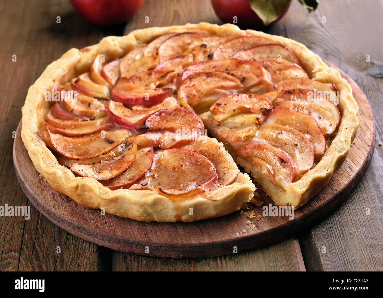 Pie with fresh apples on wooden table, close up view - Stock Image