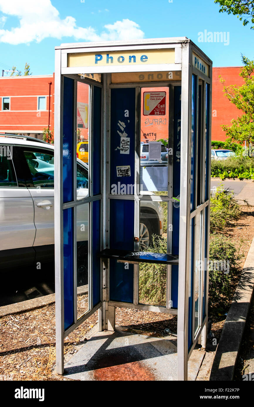 A disused AT&T public phone kiosk - Stock Image