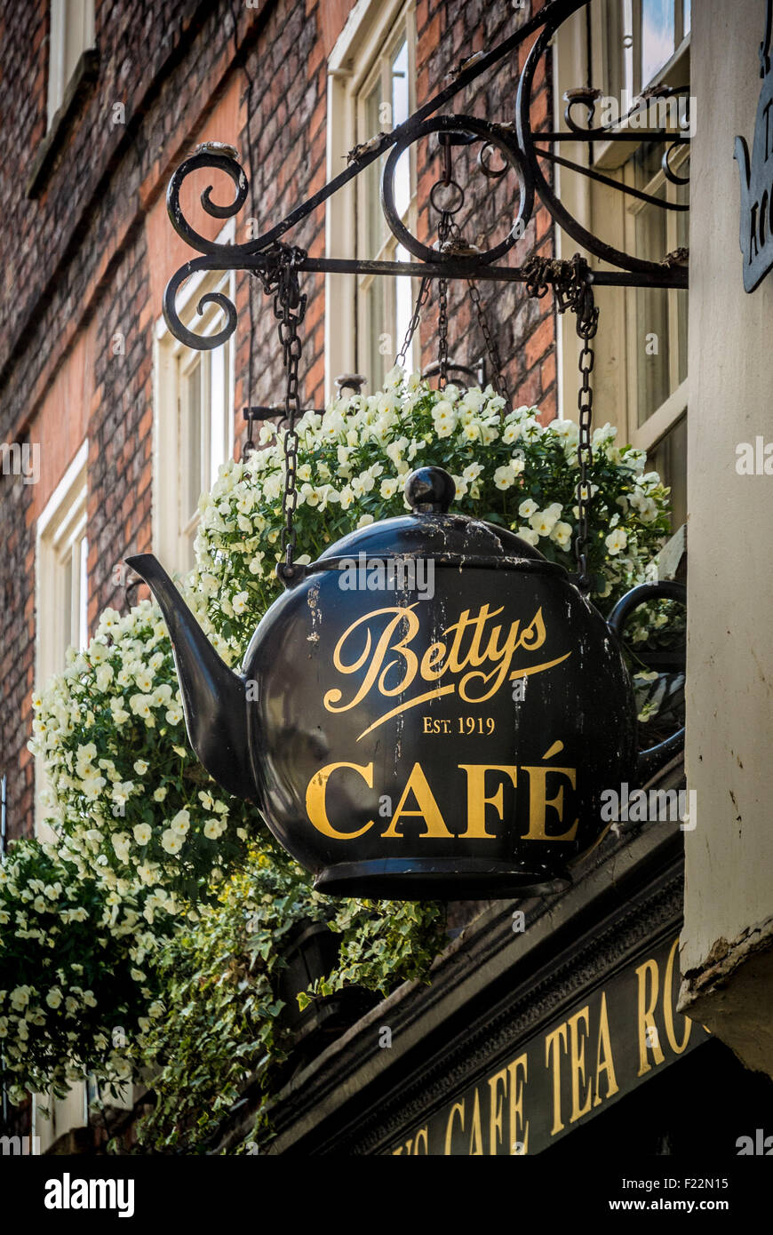 Teapot shaped exterior sign at Little Bettys Cafe - Stock Image