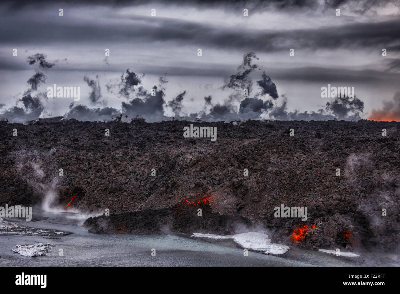 Hot lava steaming. Eruption site at Holuhraun near Bardarbunga Volcano, Iceland. August 29, 2014 a fissure eruption - Stock Image