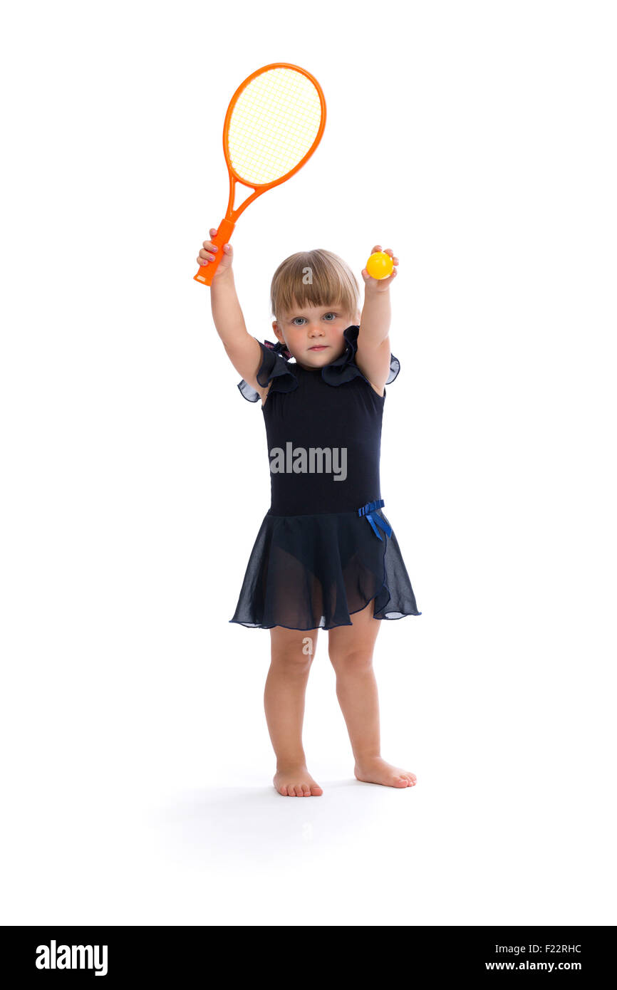 Little girl playing tennis in the studio. Isolate on white. - Stock Image