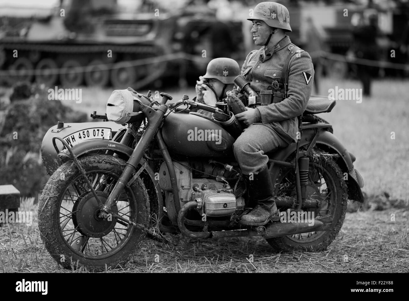 World war 11 German soldiers on A BMW Motorcycle with sidecar  on the Battlefield - Stock Image