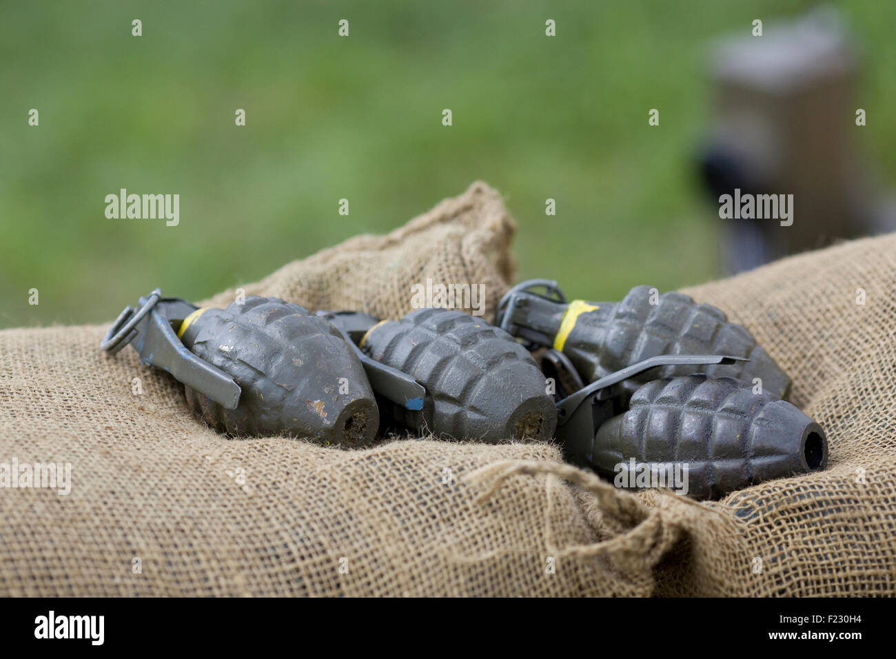 World War 2 American Hand Grenades on a burlap sack - Stock Image
