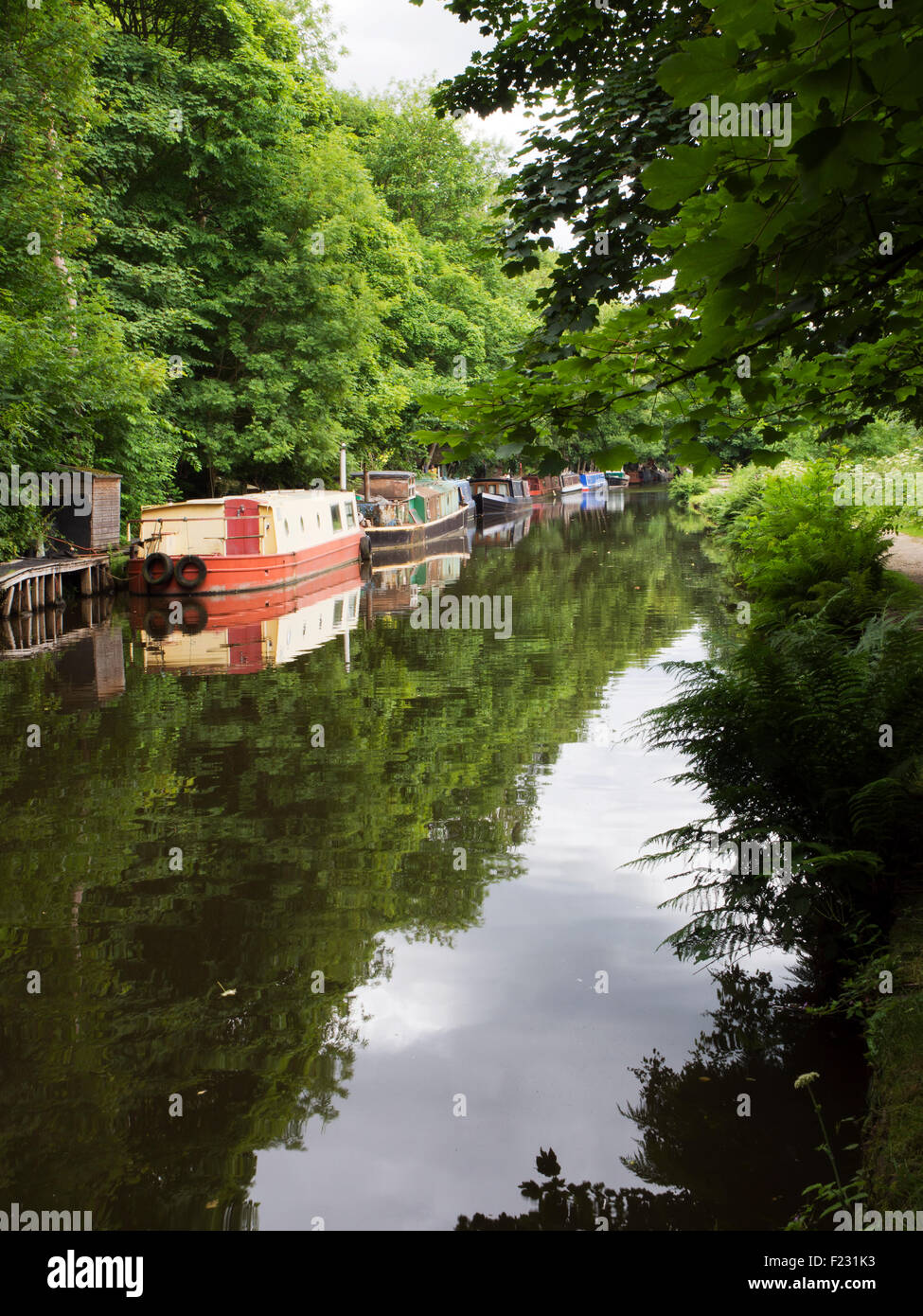 Canal Boats at Mayroyd Moorings in Hebden Bridge West Yorkshire England - Stock Image
