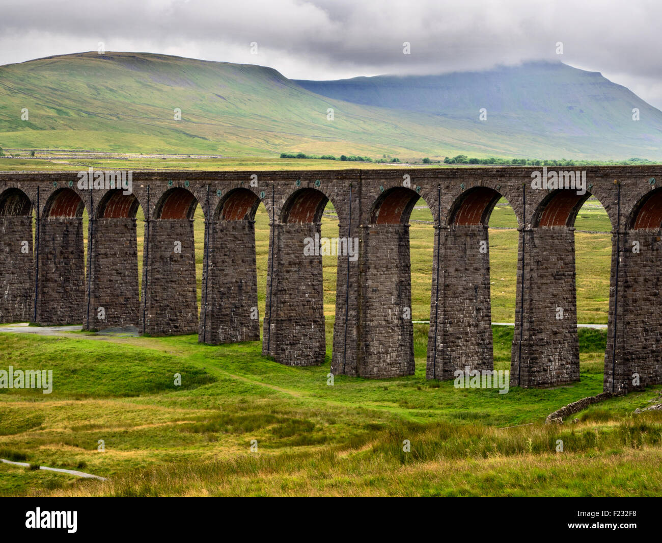 Arches of the Ribblehead Viaduct with Ingleborough Shrouded in Cloud Yorkshire Dales England - Stock Image