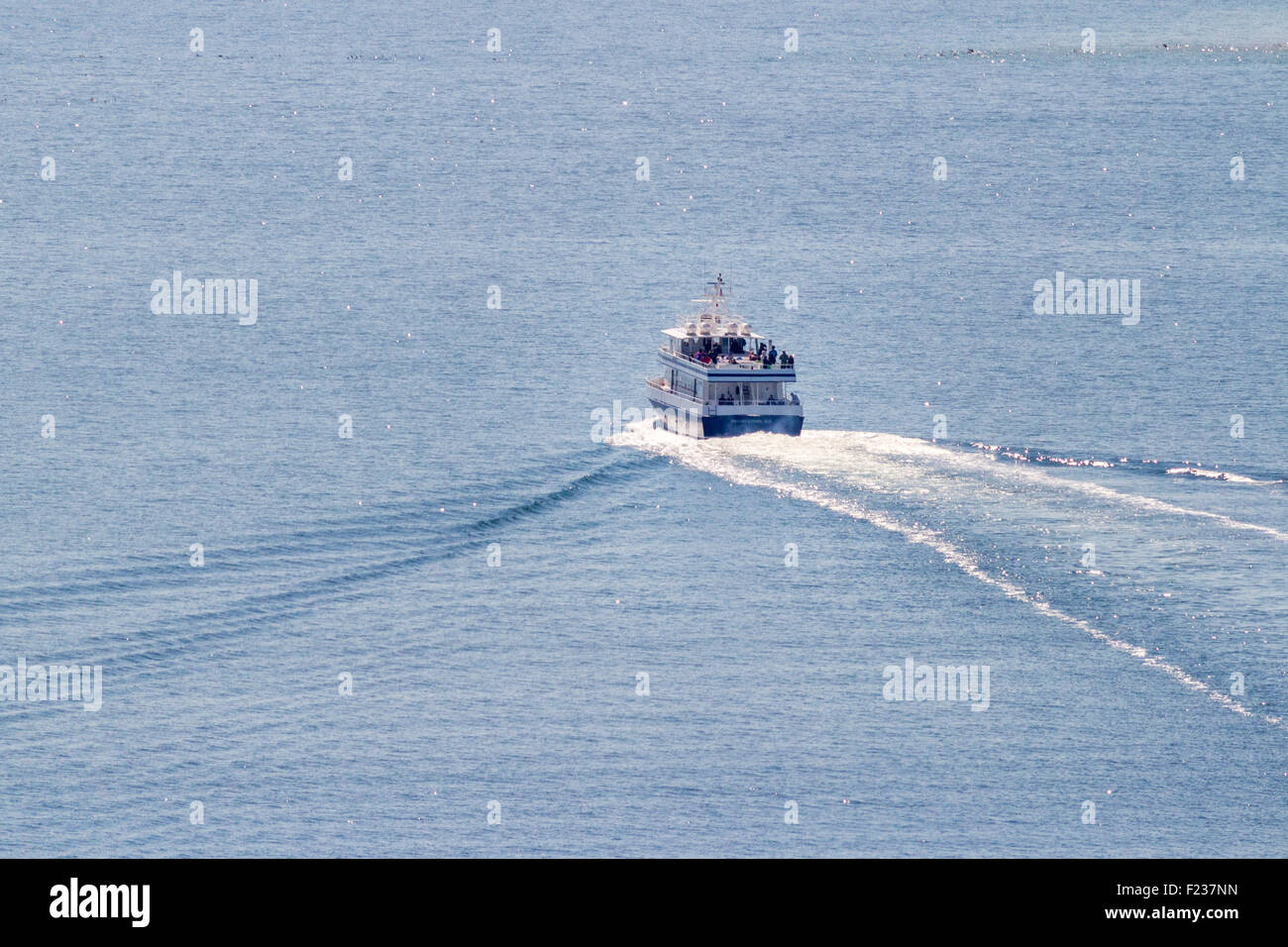 A whale watch boat traveling to see the whales. - Stock Image