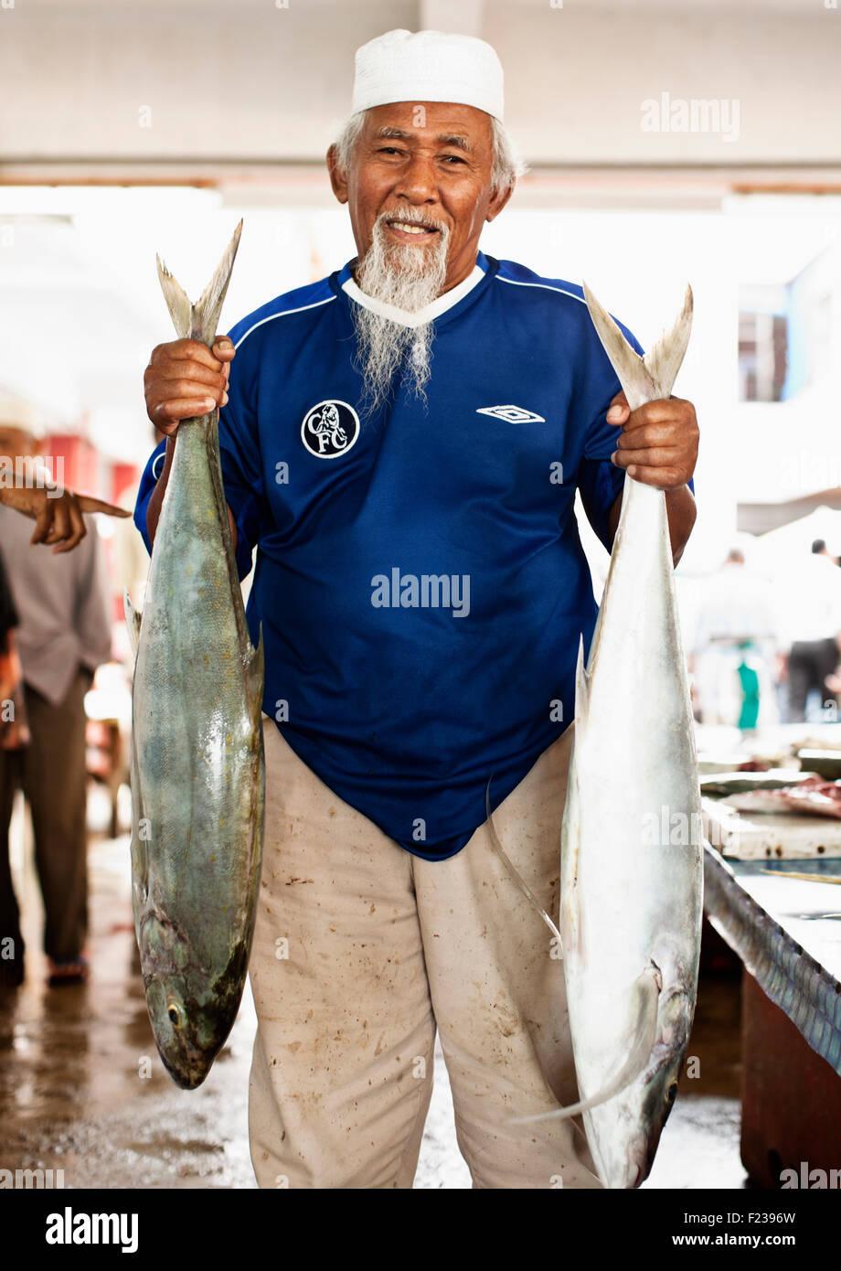 A fish hawker at the Dungun Morning Market. Dungun. Malaysia - Stock Image