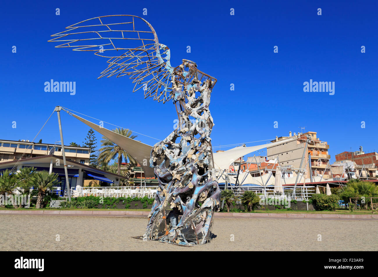 Nike sculpture on beach by Camelo Mendola, Giardini Naxos City, Sicily Island, Italy, Europe - Stock Image
