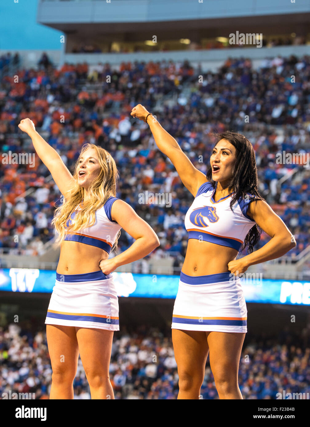 Football,Cheerleaders cheering  on Boise State University Football team against Washington, Boise, Idaho 2015 - Stock Image