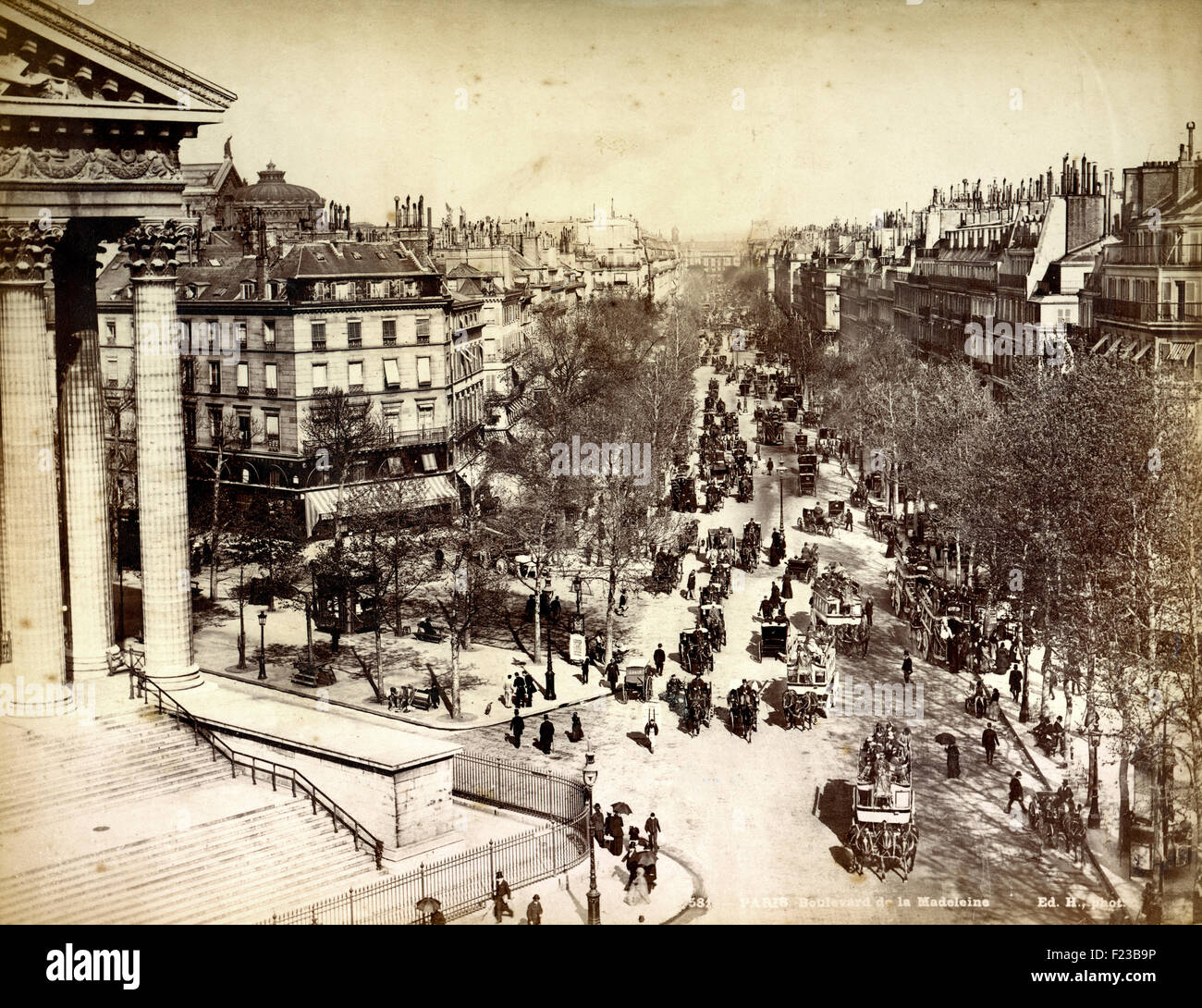 Antique photograph of the Boulevard de la Madeleine, Paris, filled with horses and carriages, in the late 19th Century Stock Photo