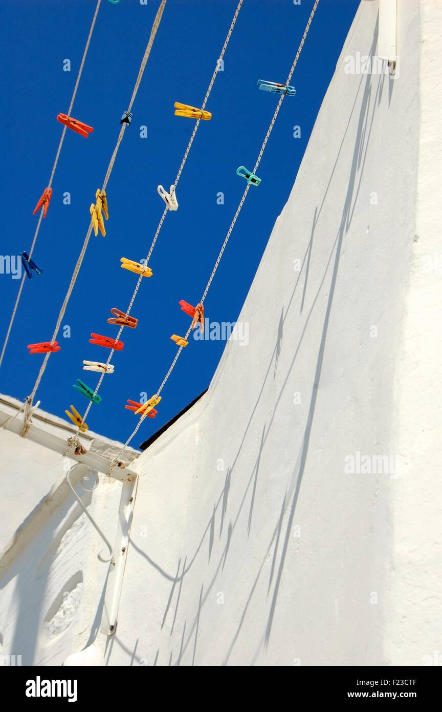 colored plastic pegs on a washing line in Amorgos Greece - Stock Image