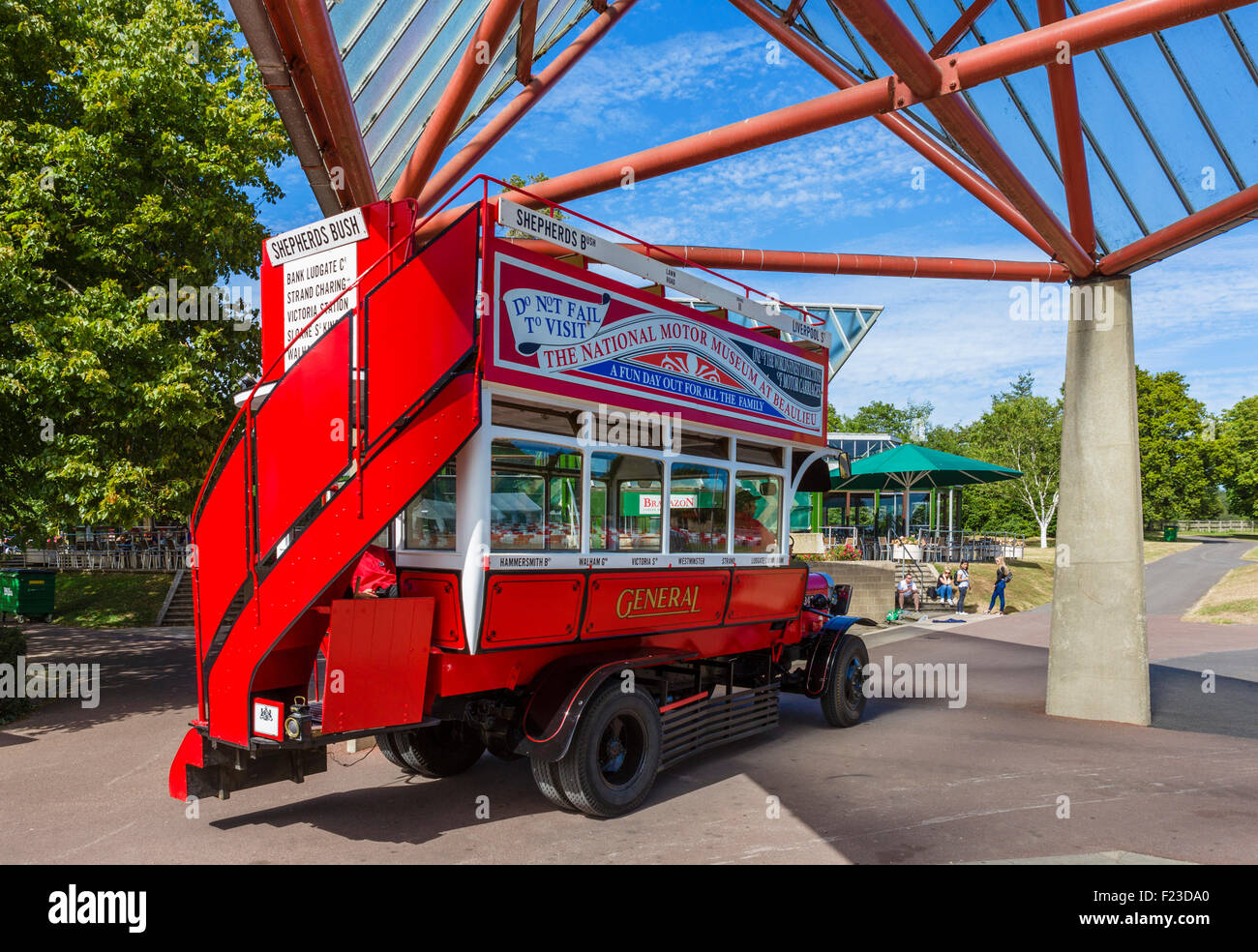 Old bus for transporting visitors, outside the National Motor Museum, Beaulieu, Hampshire, England, UK - Stock Image