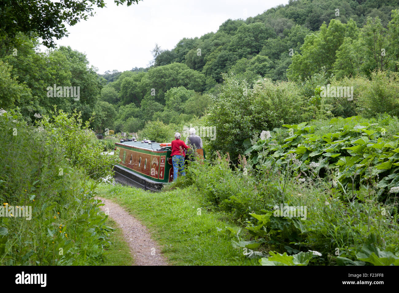 Narrow boat navigating The Caldon Canal between Kingsley and Froghall and Consall Churnet Valley Staffordshire England - Stock Image