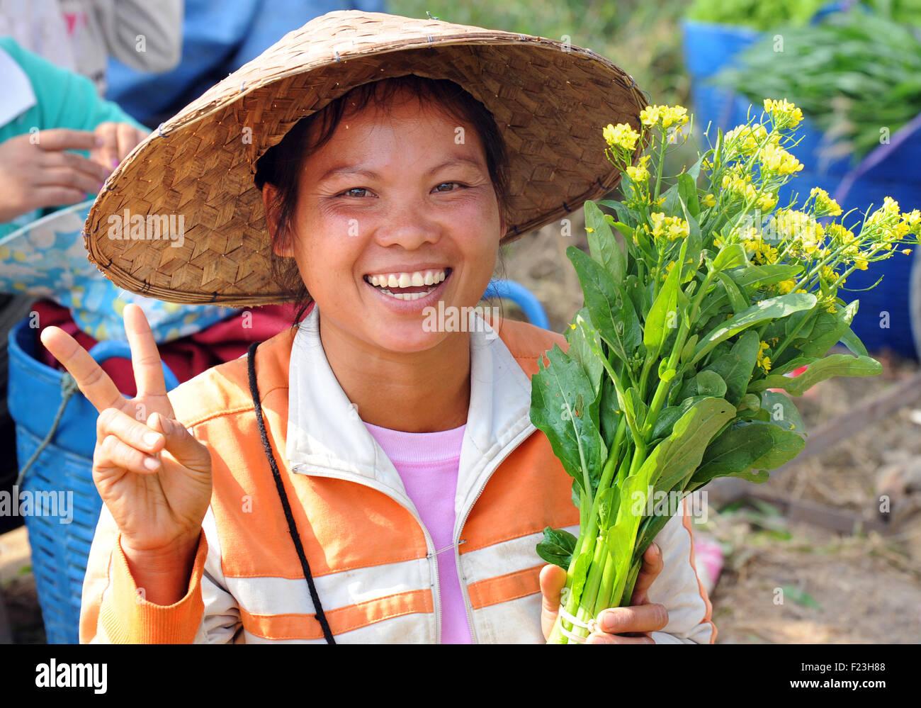 Lao woman at market gives peace gesture, Luang Prabang, Laos Laotian. - Stock Image