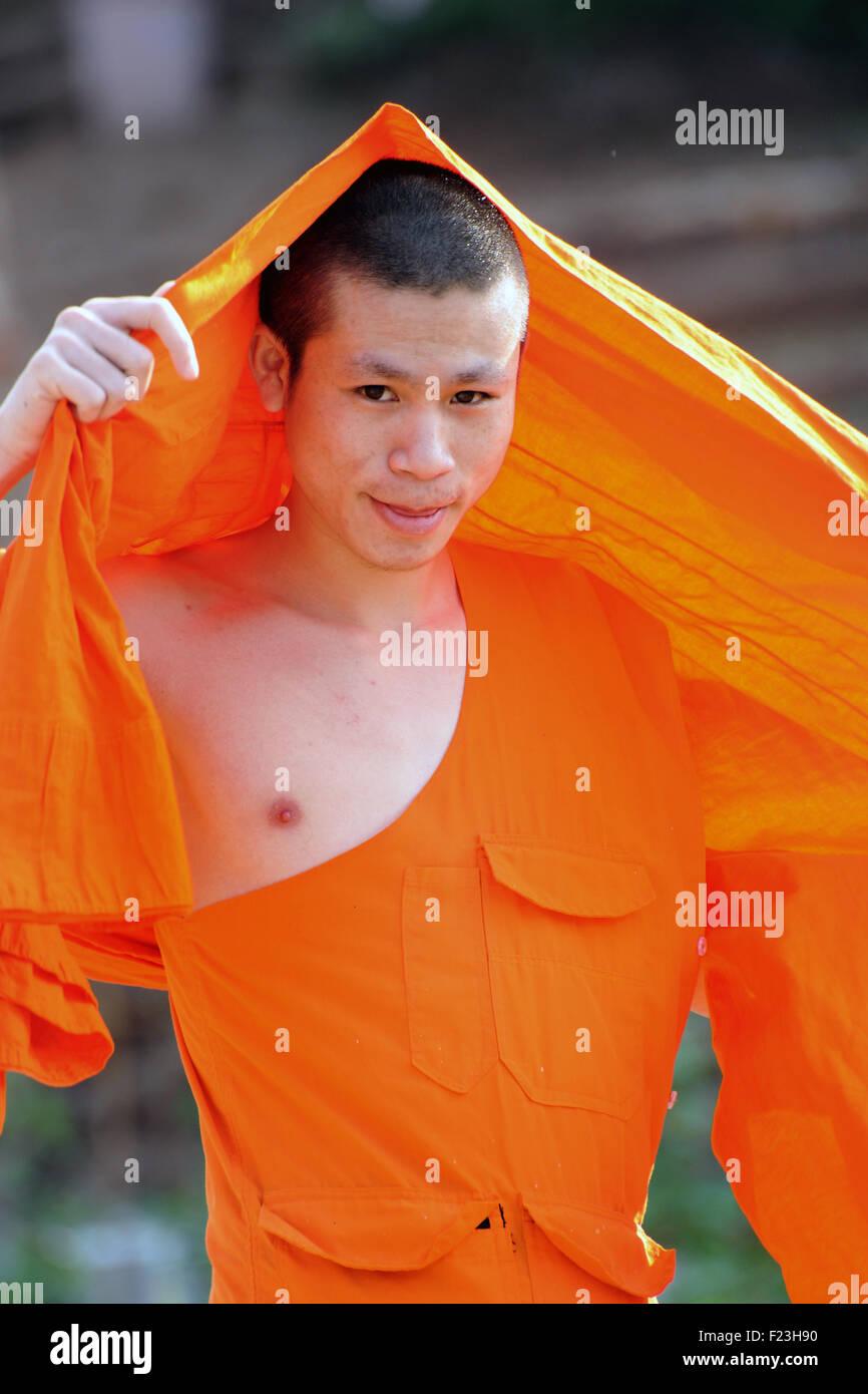 Lao monk in saffron robes Luang Prabang, Laos - Stock Image