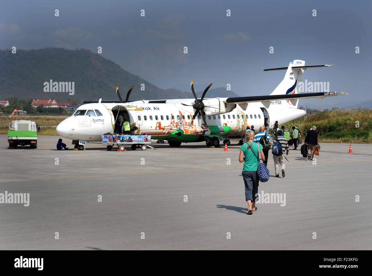 Boarding a Bangkok Air ATR72  flight, Luang Prabang airport, Laos. - Stock Image