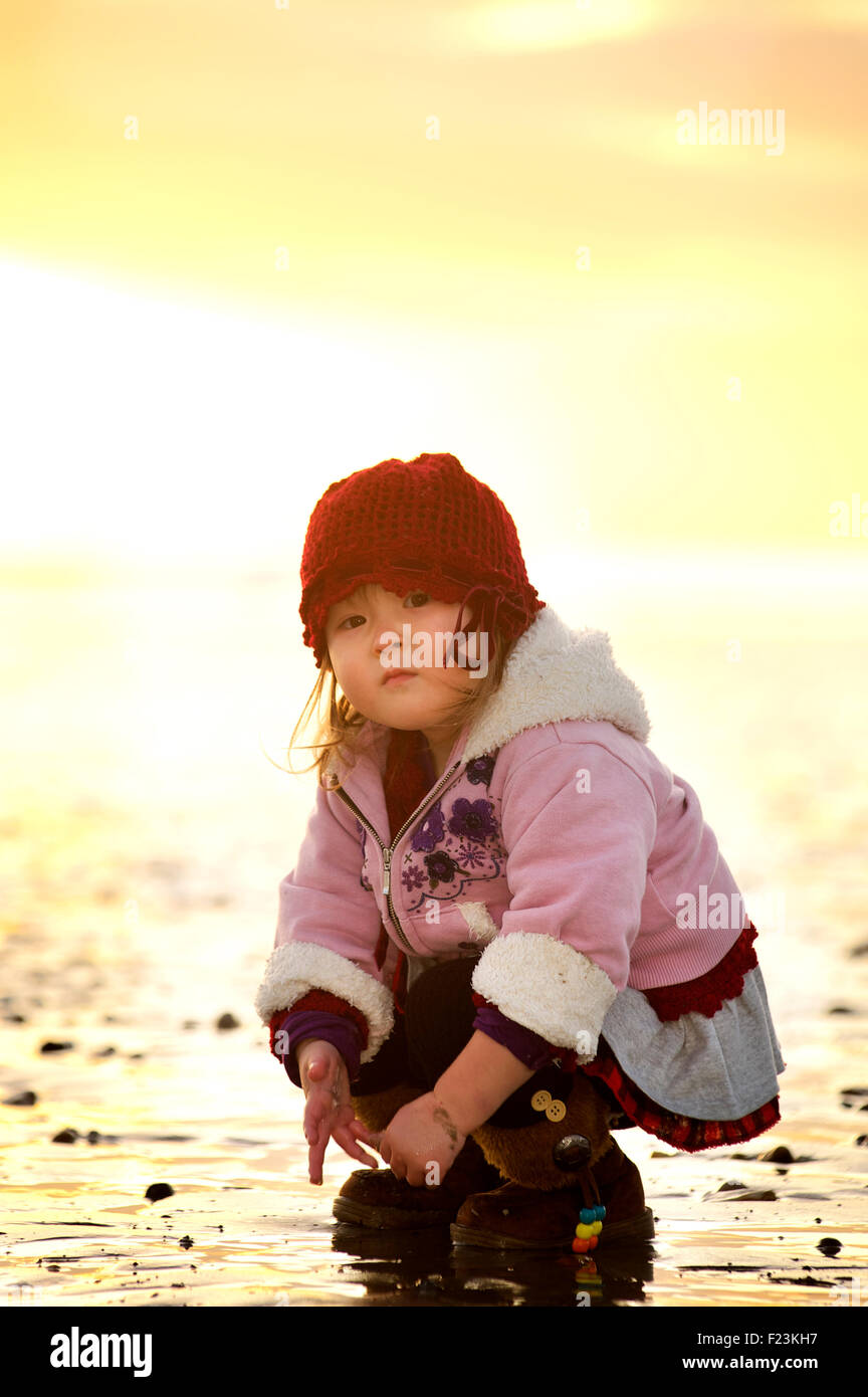 Toddler on the beach at low tide. Model Released - Stock Image
