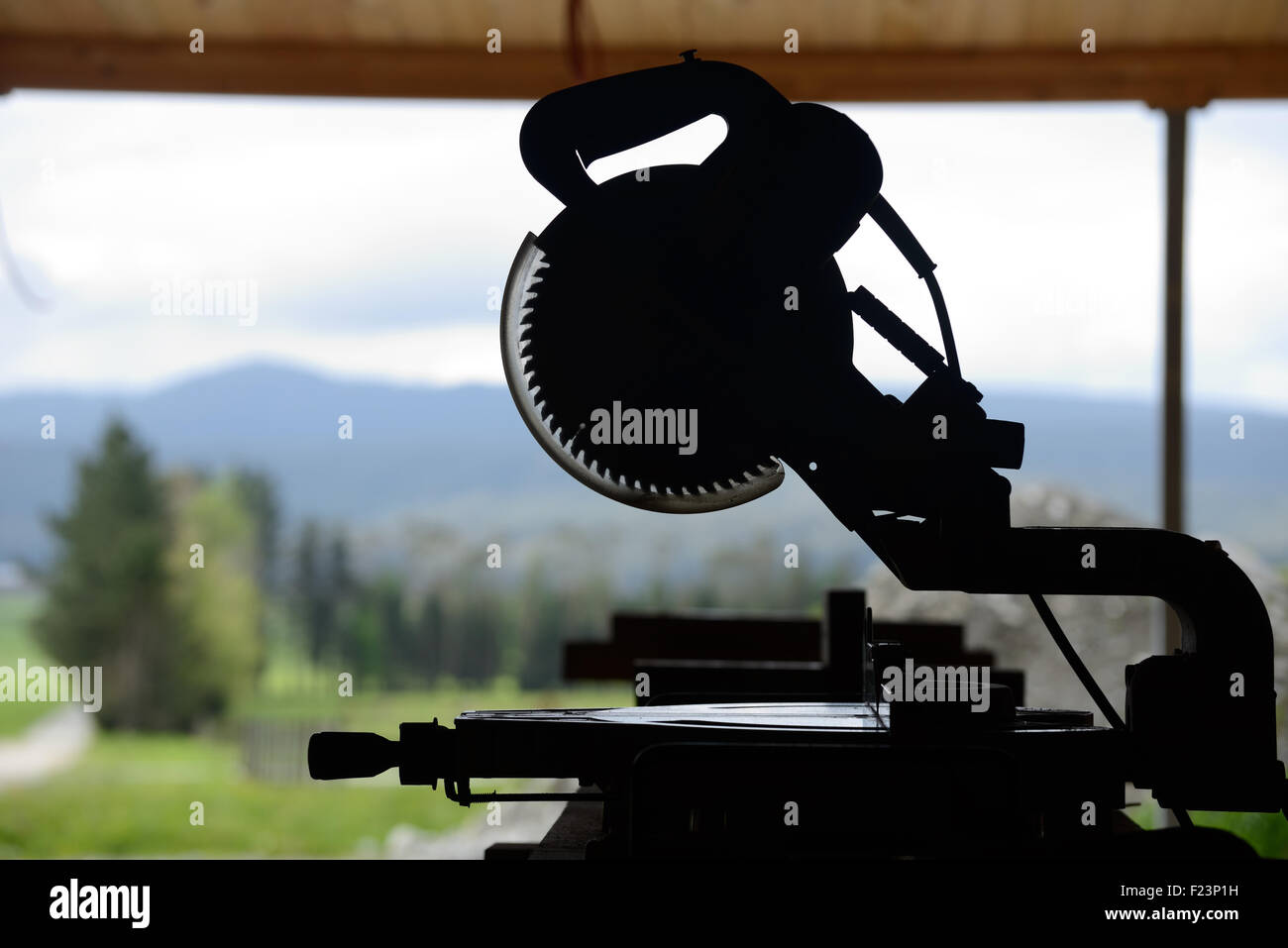 Silhouette of saw bench on a construction site - Stock Image
