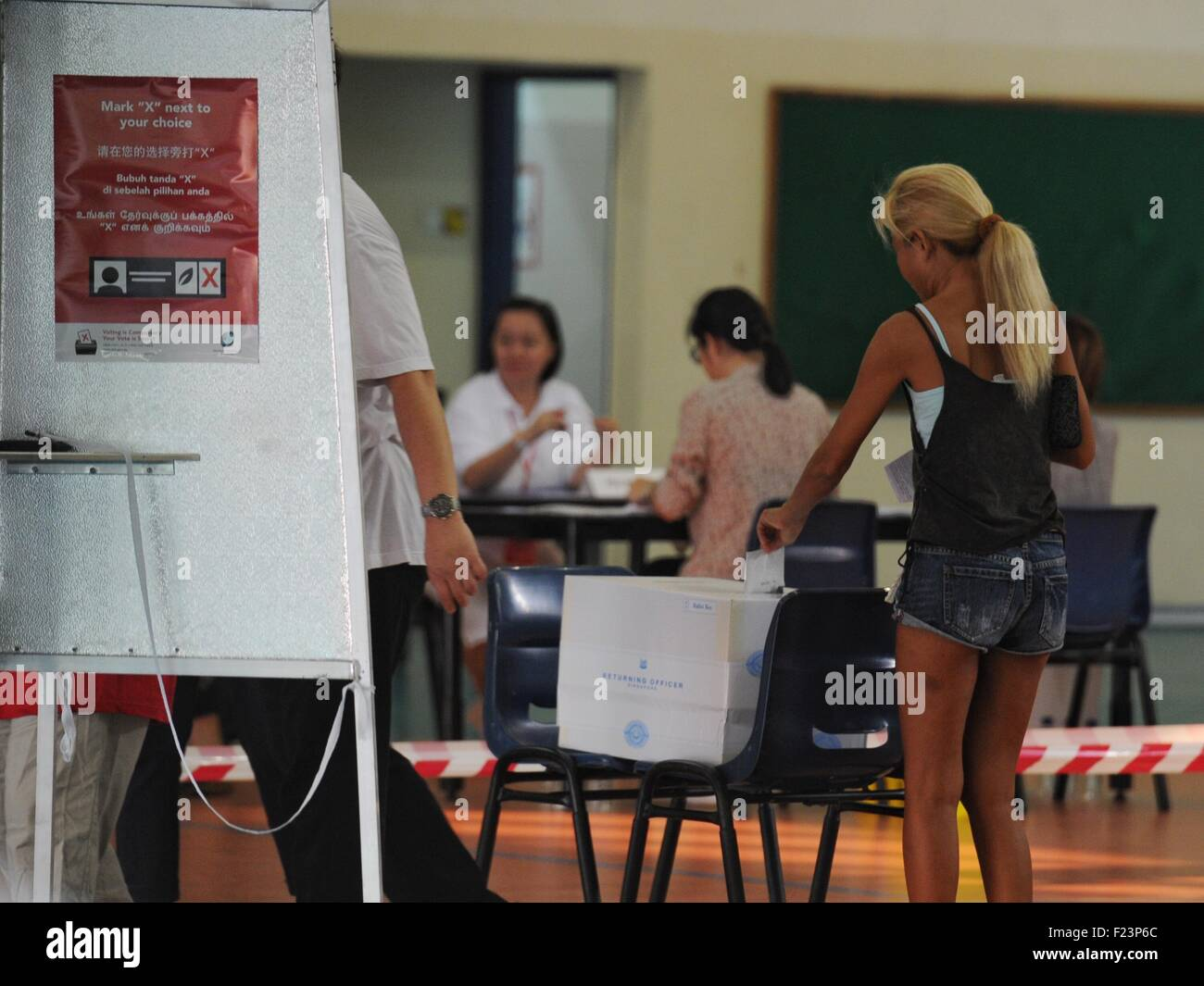 Singapore. 11th Sep, 2015. Singaporeans vote at a polling station at Singapore's Toa Payoh, Sept. 11, 2015. - Stock Image