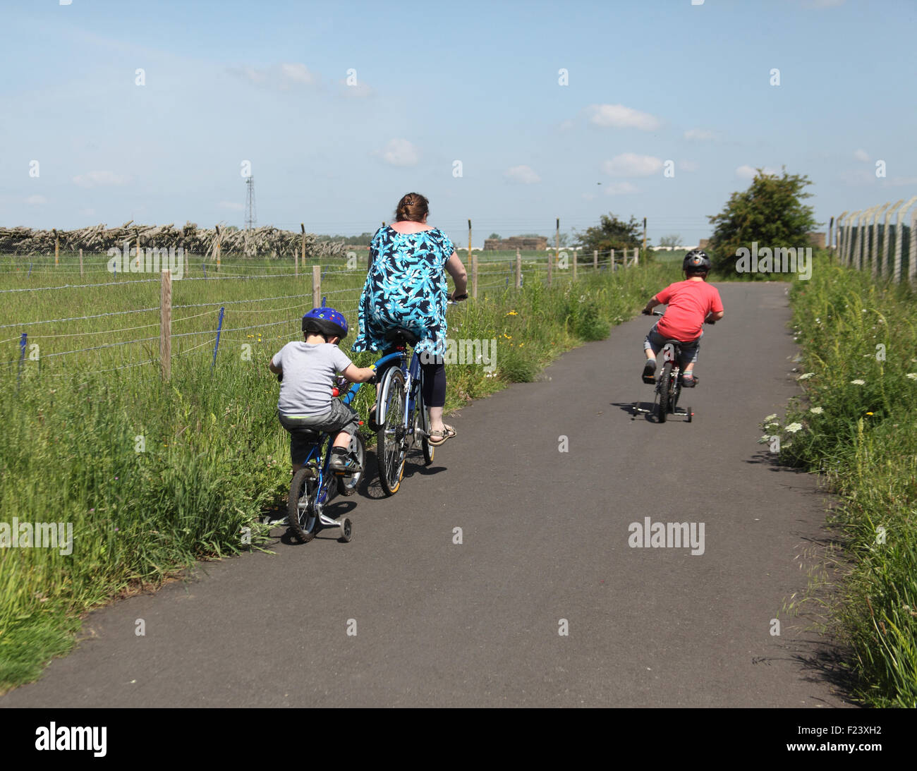 Mother and children using cycle path at Watton in Norfolk - Stock Image