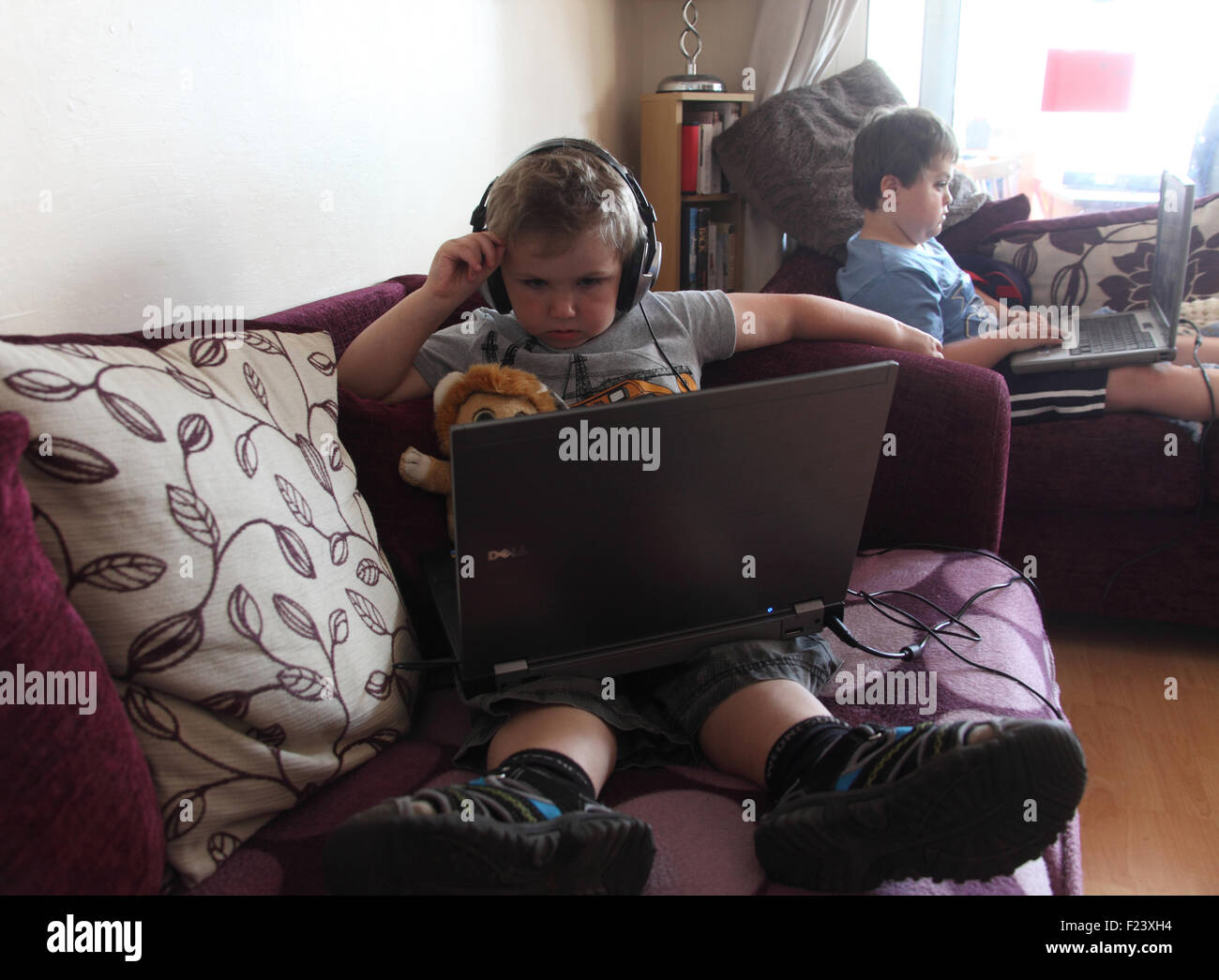 Young boys using laptop computers - Stock Image