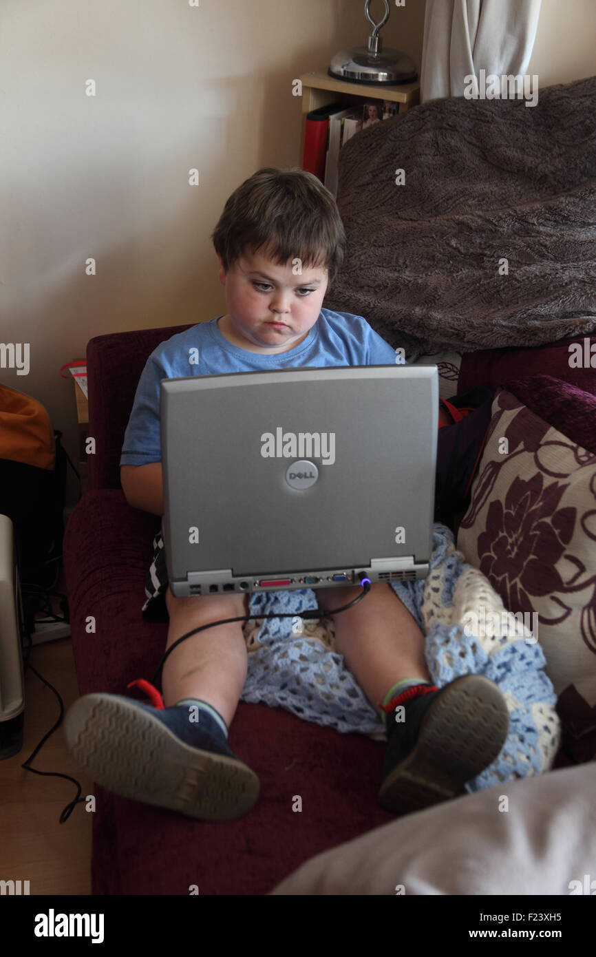 Young boy using laptop computer - Stock Image