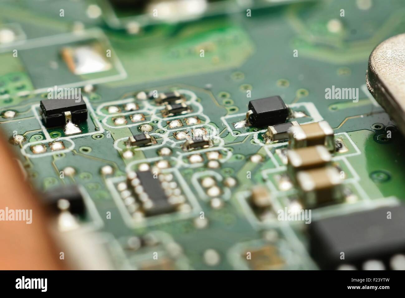 micro electronics main board with processors, diodes, transistors (develop and manufacturing electronics background) - Stock Image