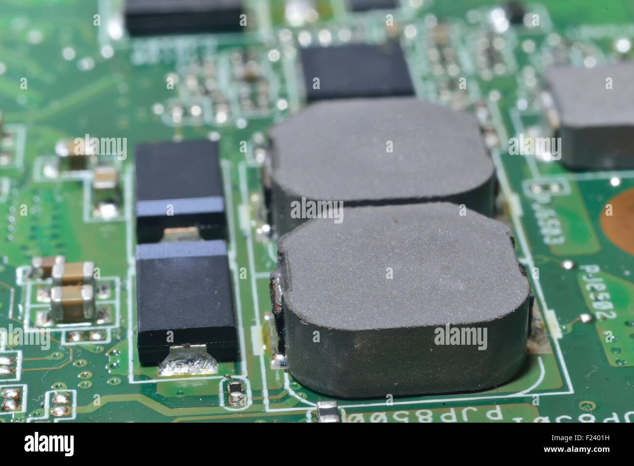 macro zoomed capacitors and chips on motherboard - Stock Image