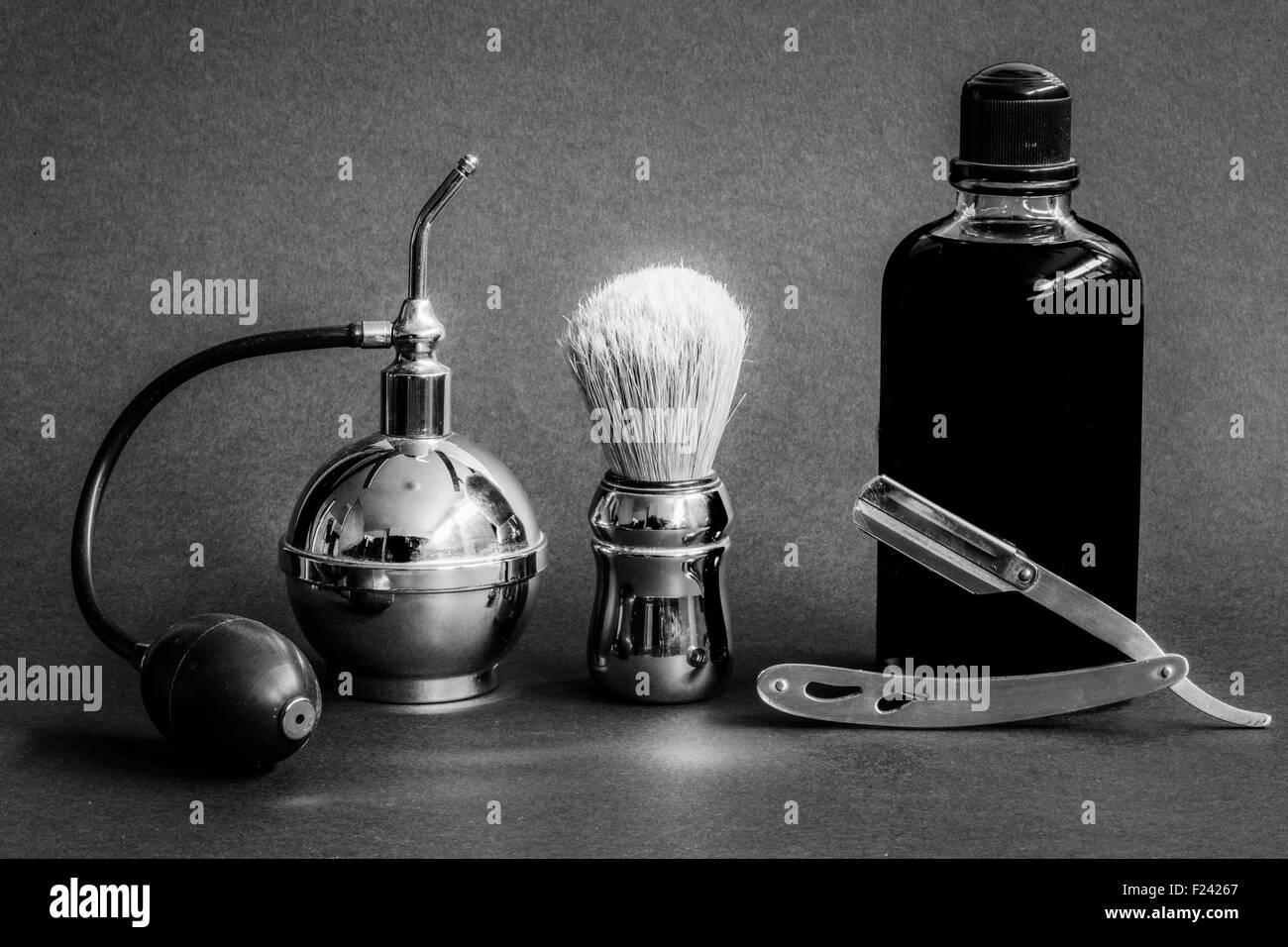 vaporizer shaving brush and perfume - Stock Image