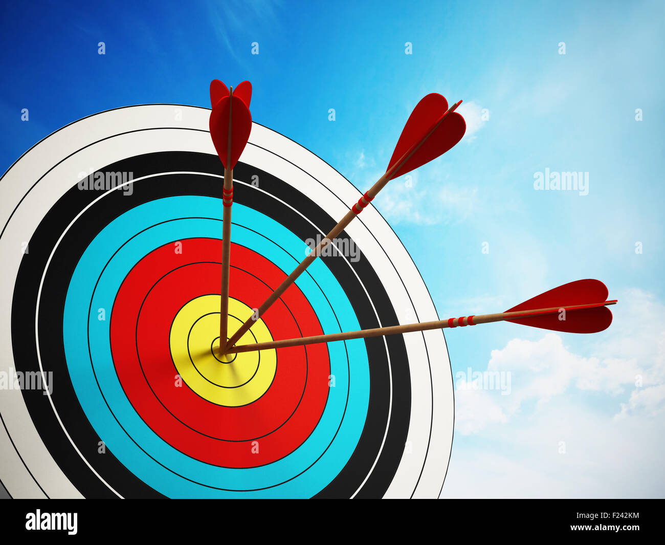 Three arrows at the center of the target. - Stock Image