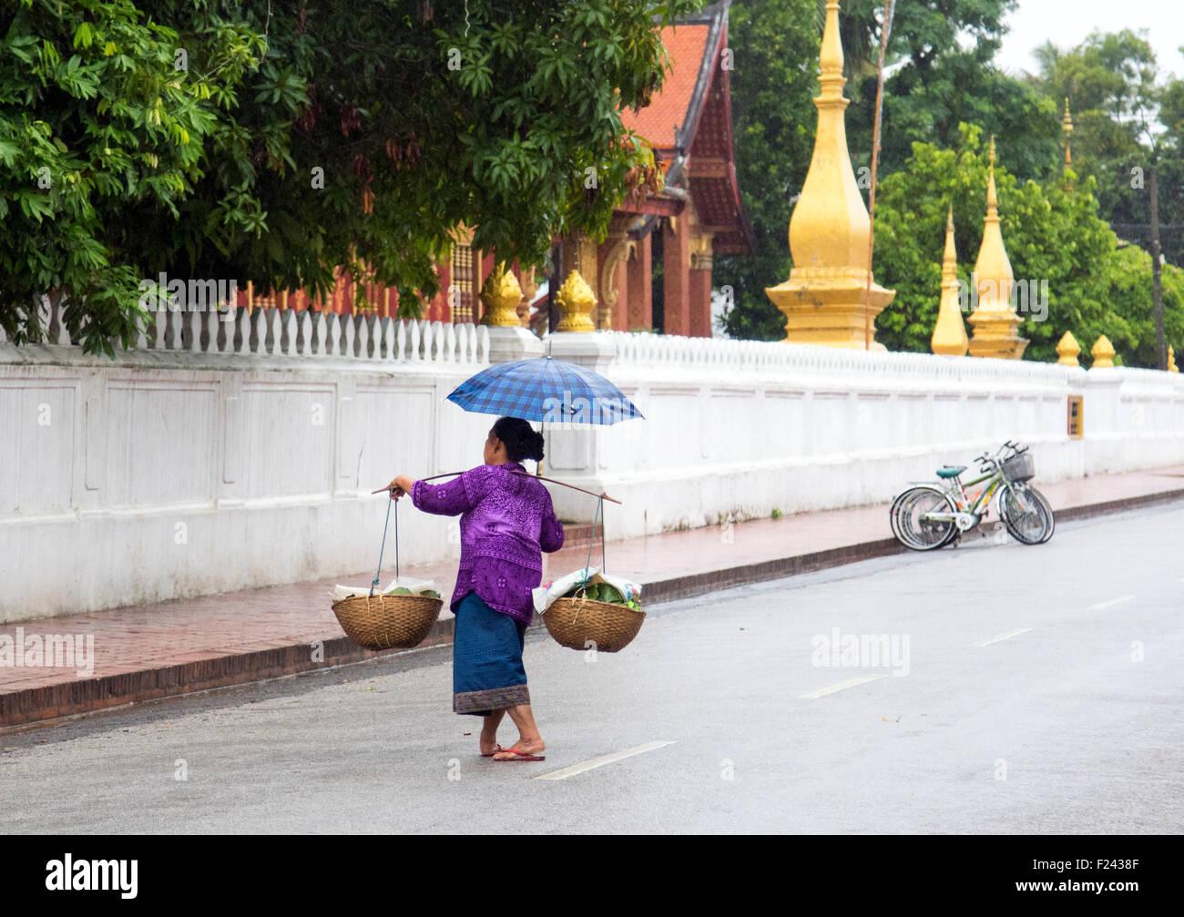 carrying pole shoulder pole milkmaid's yoke woman - Stock Image
