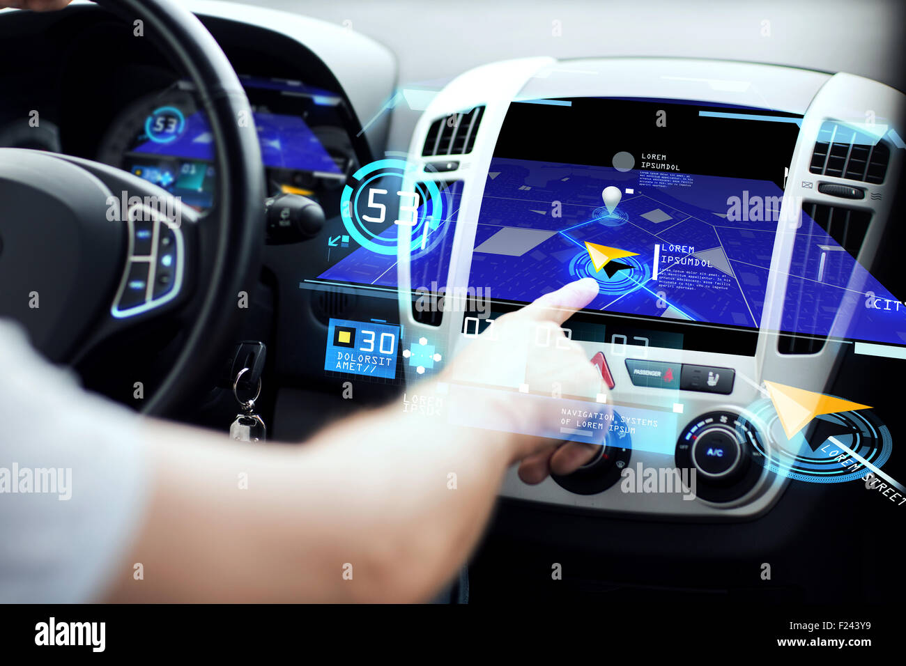 male hand using navigation system on car dashboard - Stock Image