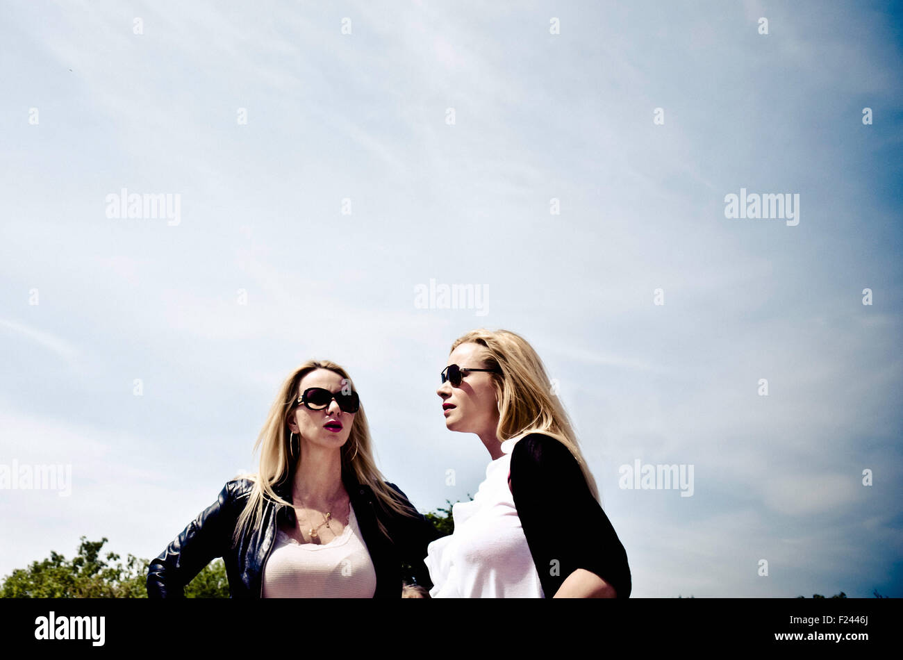 two blond women with sunglasses - Stock Image