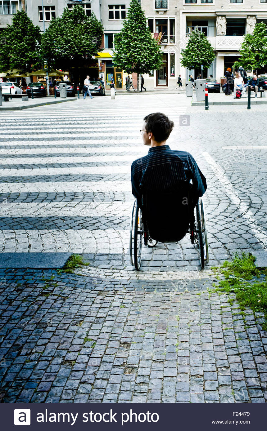 disabled man in wheelchair - Stock Image