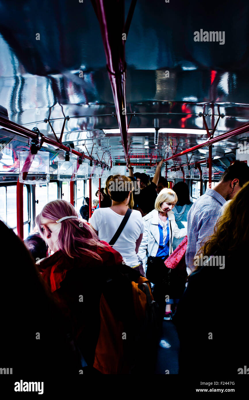 people inside a city bus - Stock Image
