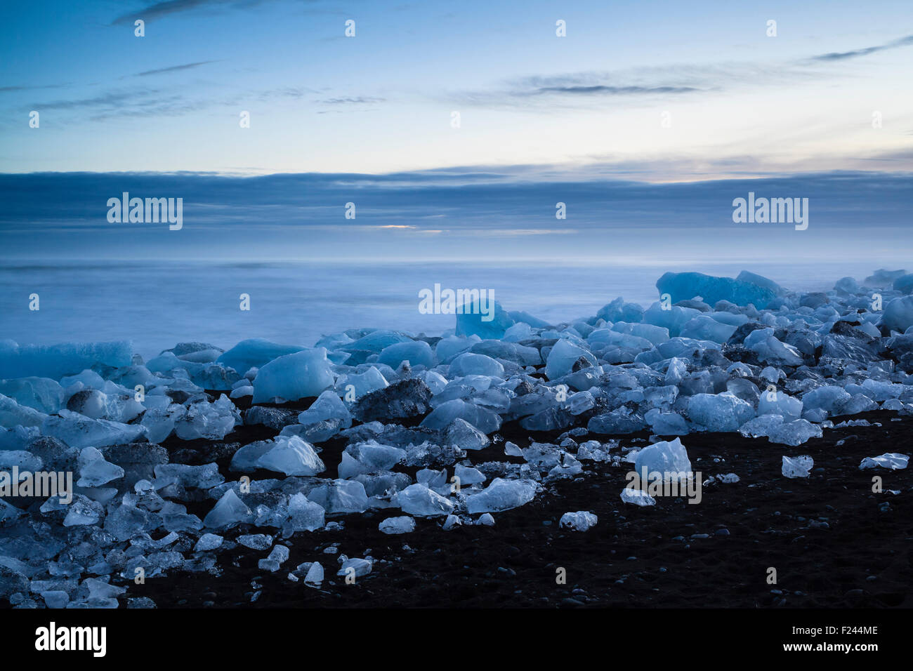Icebergs from the Jokulsarlon glacial lagoon washed up on a black volcanic sand beach. South Iceland. Stock Photo