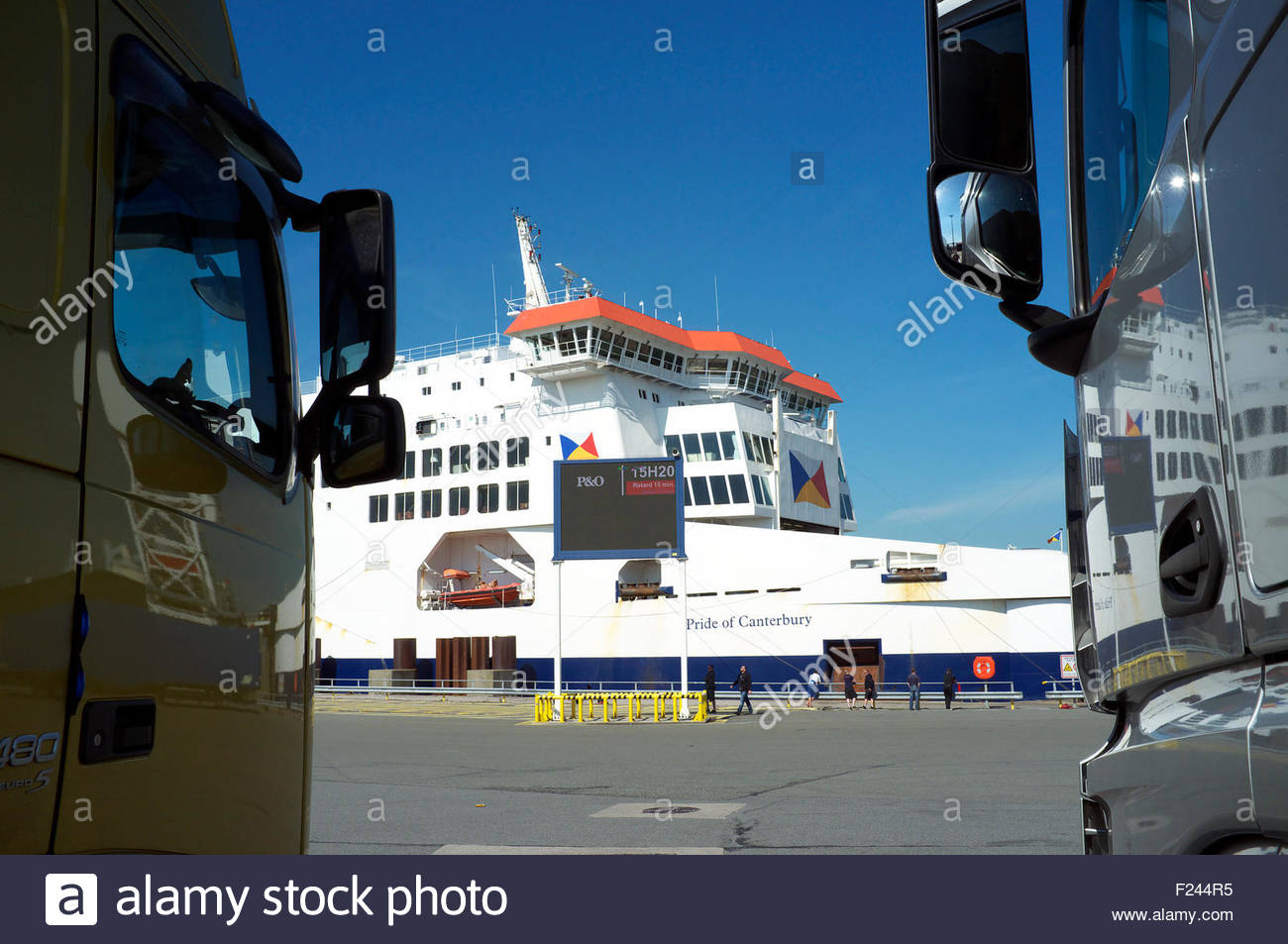 Trucks waiting to embark a Dover bound P & O ferry at Calais, in northern France. - Stock Image