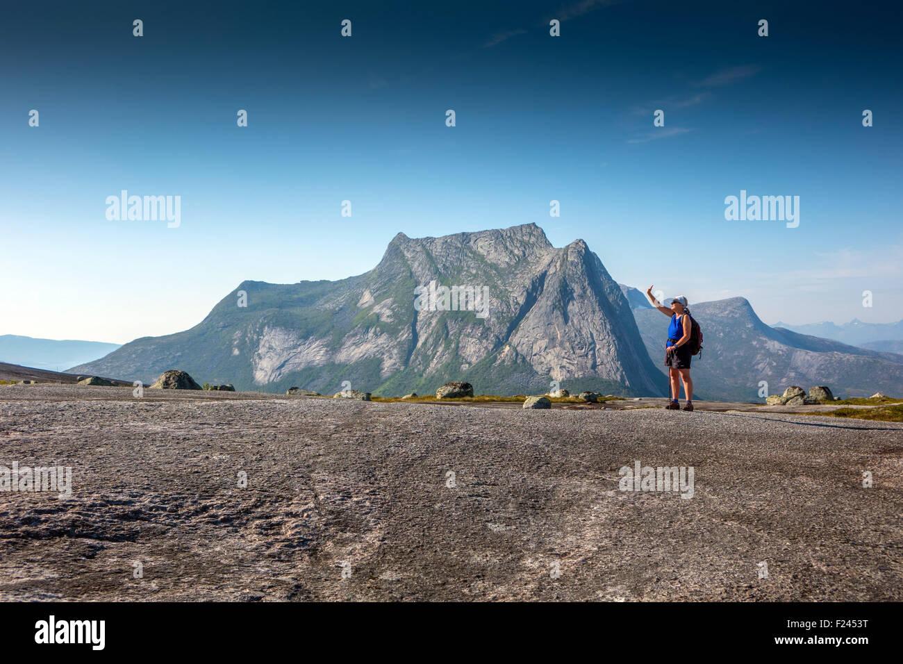 Small solitary figure on Verdenssvaet Worlds Slab, huge granite slab