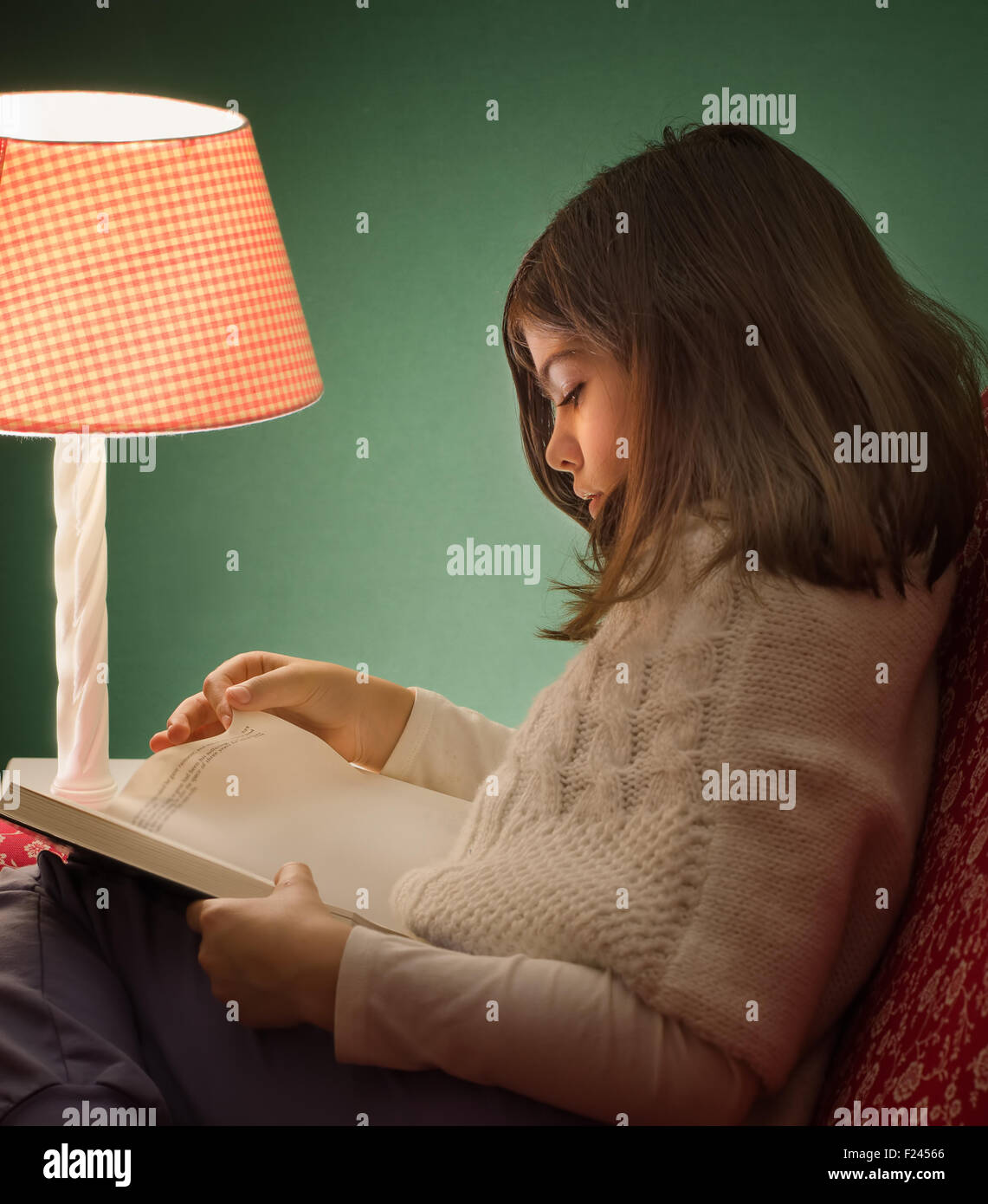Little girl reading a book, under light of pink lamp, with green ... for Little Girl With Lamp  585eri