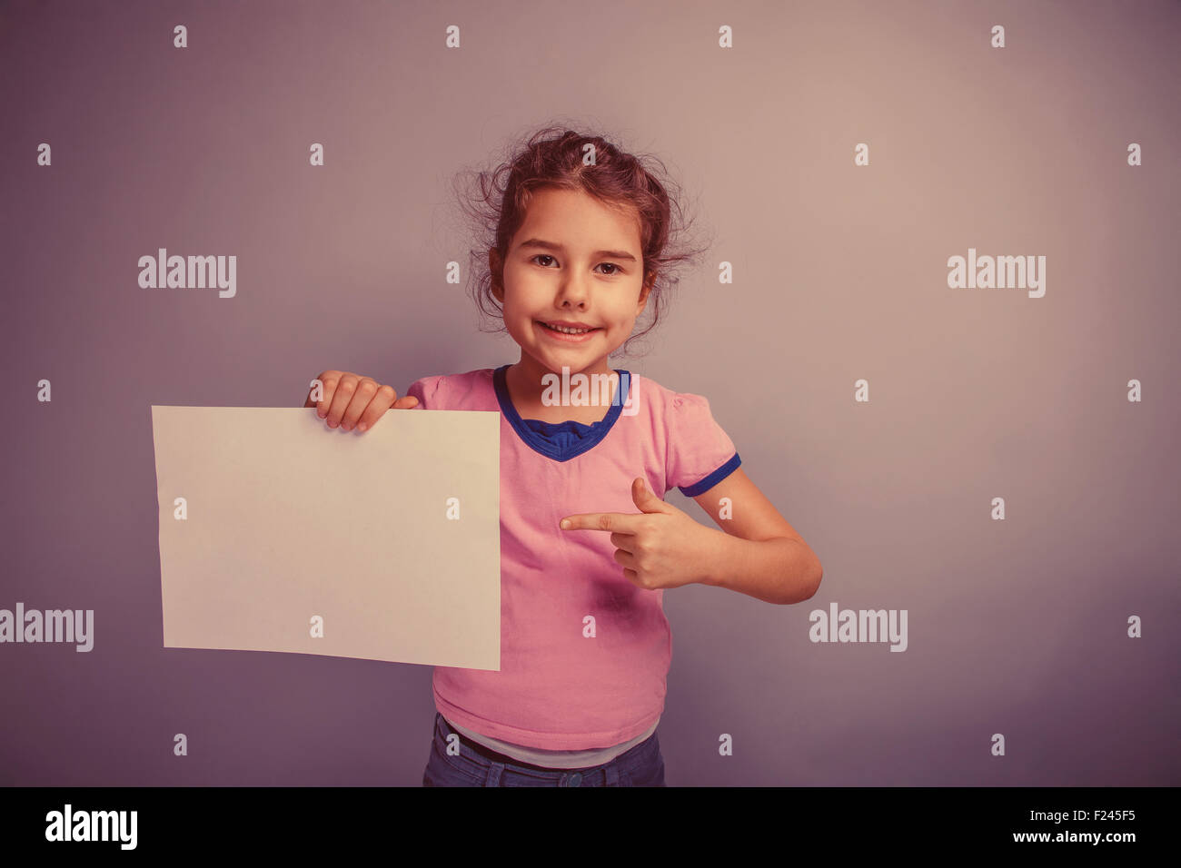 girl child 6  years of  European appearance holds a clean sheet - Stock Image