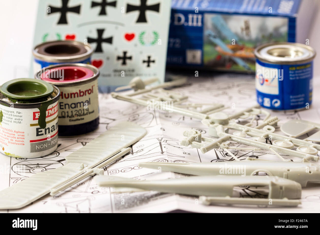 Revell first world war model aircraft kit, instruction sheet, spurs with parts on, tins of modelling paint and transfer - Stock Image