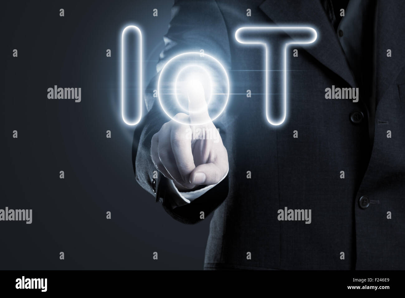 Man touching IoT (internet of things) text on display - Stock Image
