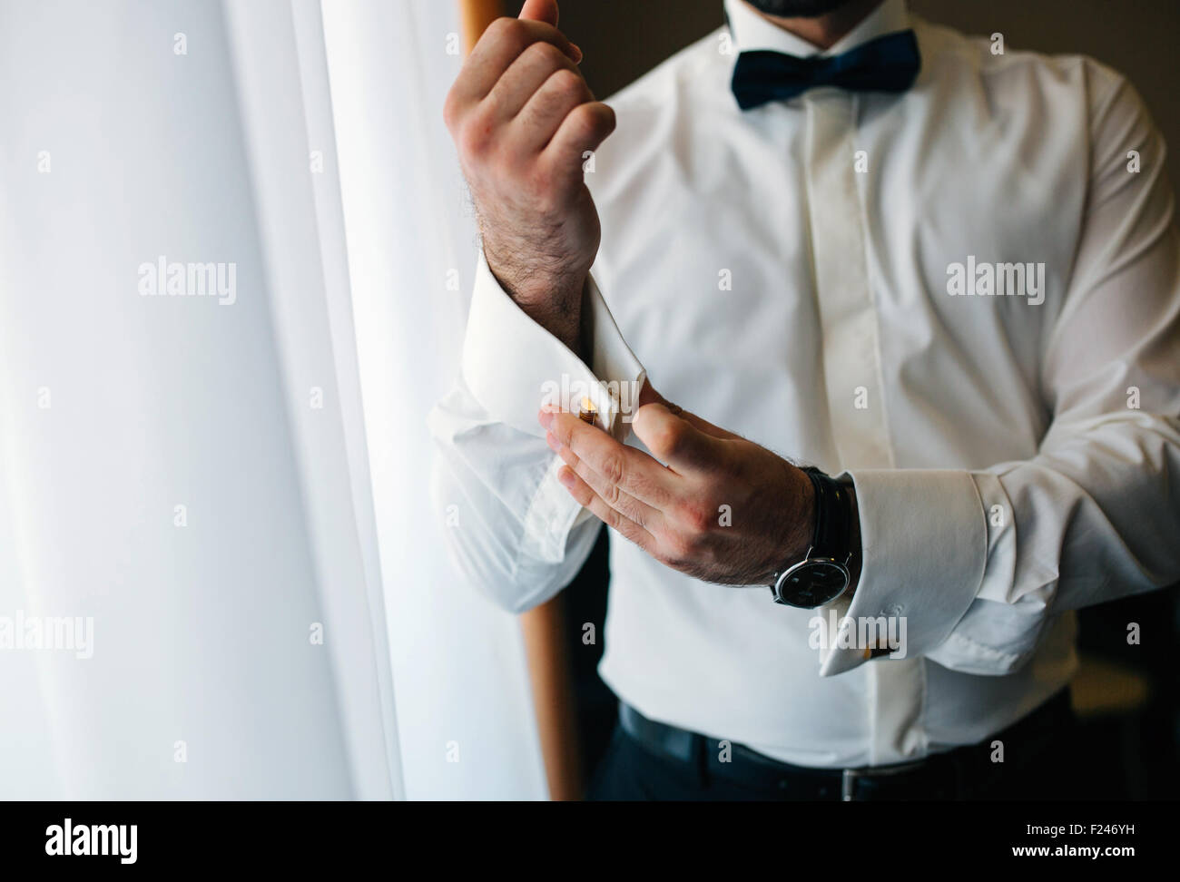groom in the apartment - Stock Image