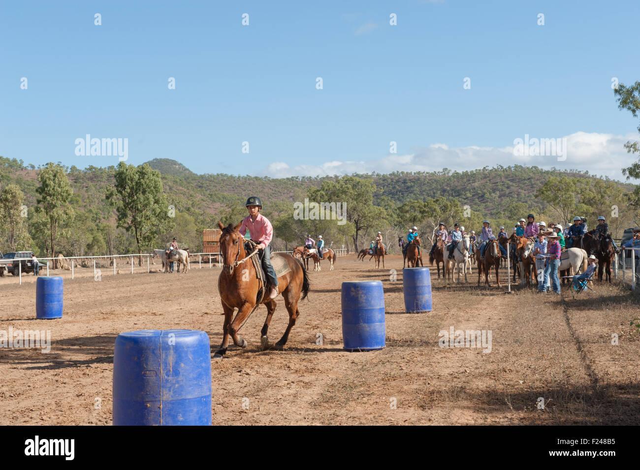 Barrel races for junior cowboys at the Eureka Creek Rodeo, northern Queensland, Australia - Stock Image