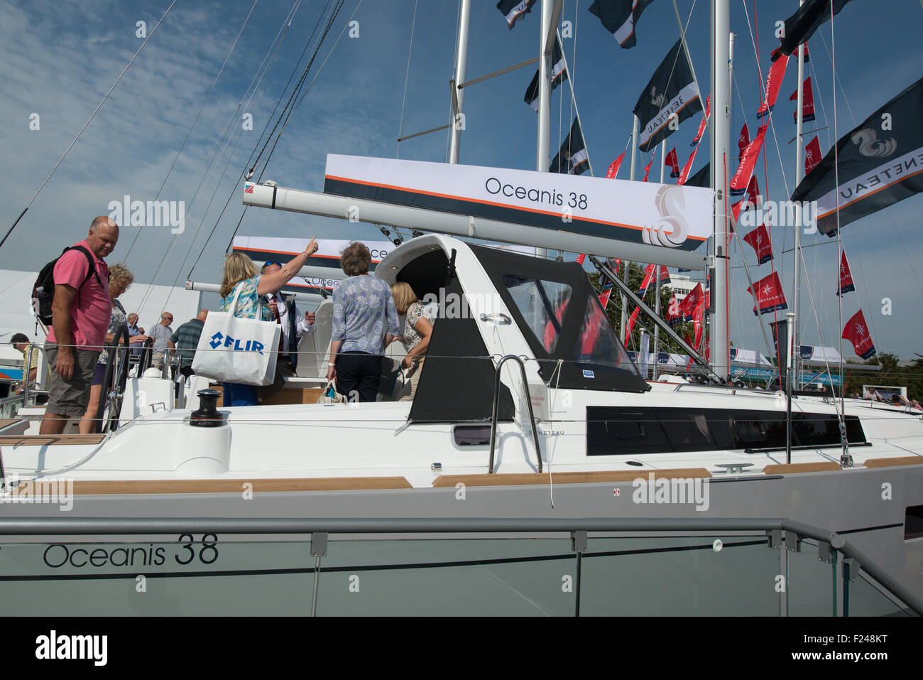 Southampton, UK. 11th September 2015. Southampton Boat Show 2015. Visitors on the Beneteau yacht stand look at an Stock Photo