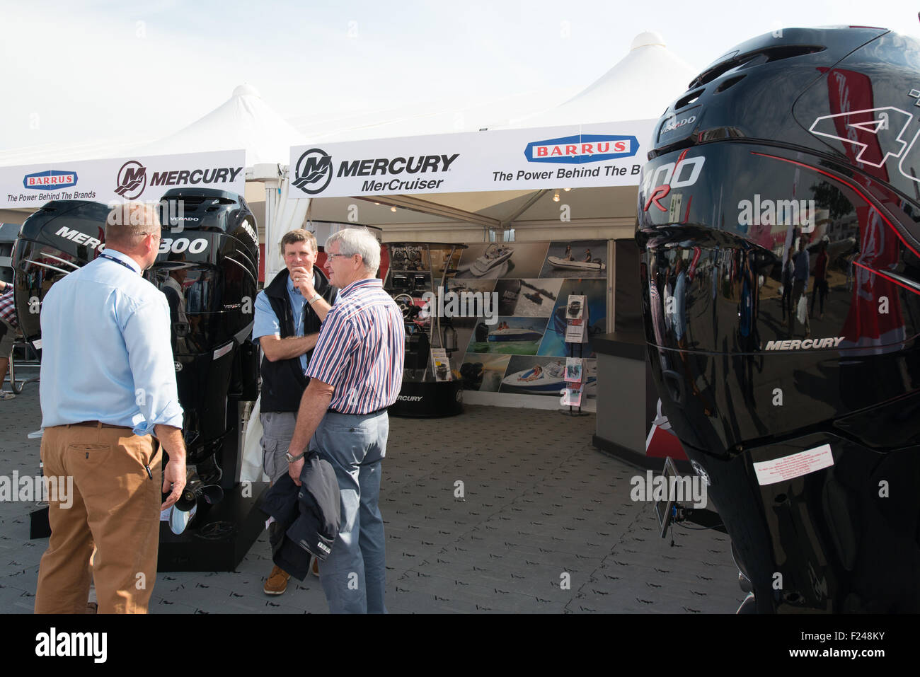 Southampton, UK. 11th September 2015. Southampton Boat Show 2015. Visitors to the Mercury stand speak with an exhibitor Stock Photo