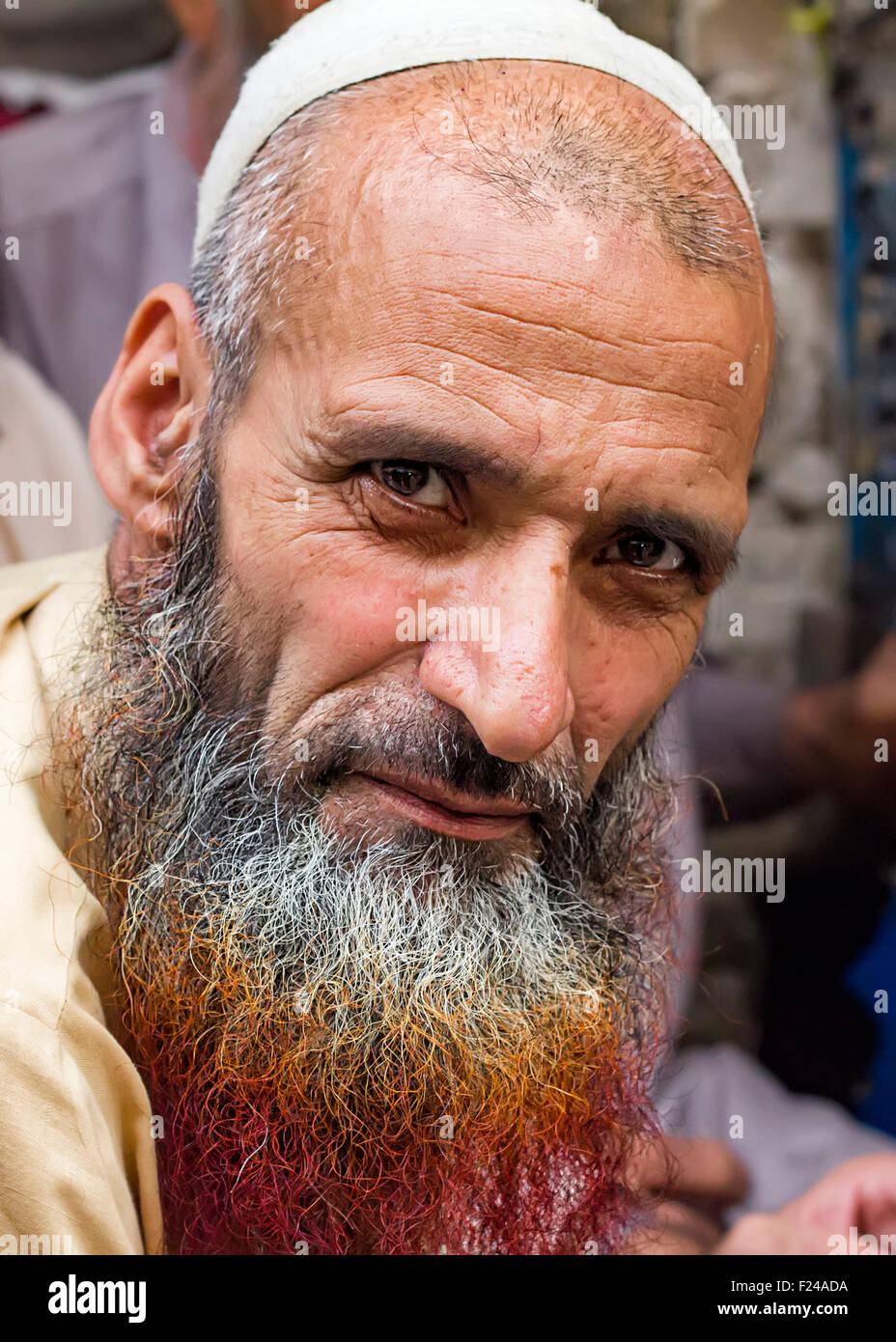 Pashto refugee in Pakistan with henna dyed beard. Many Muslim men dye their beard with henna especially during Ramadan. - Stock Image